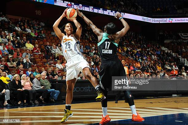 Alyssa Thomas of the Connecticut Sun shoots against Essence Carson of the New York Liberty on May 4 2014 at the Mohegan Sun in Uncasville Connecticut...