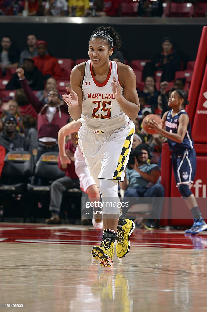Alyssa Thomas #25 of the Maryland Terrapins celebrates after scoring against the Connecticut Huskies at the Comcast Center on November 15, 2013 in College Park, Maryland.