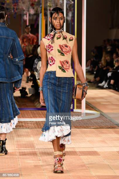 Alyssa Traore walks the runway during the Alexander McQueen Paris show as part of the Paris Fashion Week Womenswear Spring/Summer 2018 on October 2...