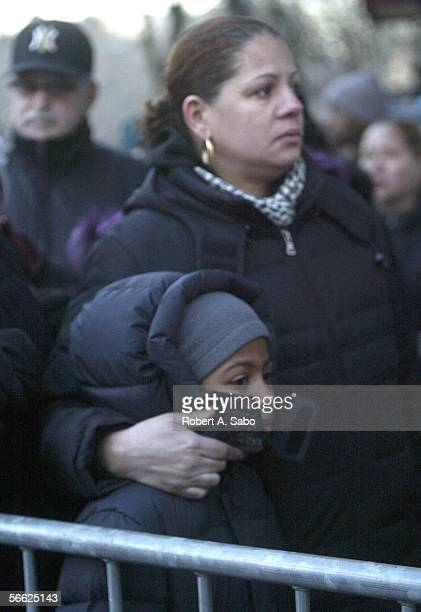 Alyssa Vasquez eightyearsold and her mother Gilicel Luperena waitinline outside the Ortiz Funeral Home with other people who read about the Nixzmary...