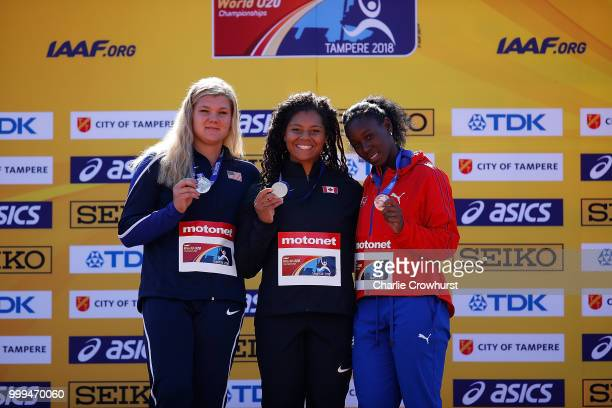 Alyssa Wilson of The USA Camryn Rogers of Canada and Yaritza Martinez of Cuba celebrate with their medals during the medal ceremony for the women's...