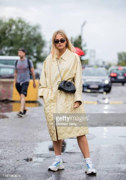 Alyssa Winter wearing yellow coat outside Baum und Pferdgarten during Copenhagen Fashion Week Spring/Summer 2020 on August 08, 2019 in Copenhagen,...