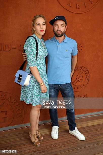 Alysson Paradis and actor Guillaume Gouix attend the 2018 French Open Day Nine at Roland Garros on June 4 2018 in Paris France