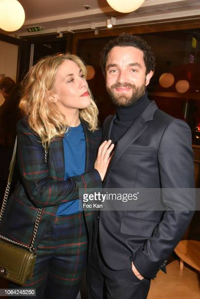 Alysson Paradis and actor Guillaume Gouix attend the Paul Smith Raspail Store 25th Anniversary Party on November 21 2018 in Paris France