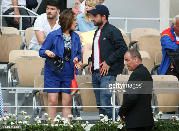 Alysson Paradis and boyfriend Guillaume Gouix attend the victory of Rafael Nadal of Spain during day 10 of the 2019 French Open at Roland Garros...