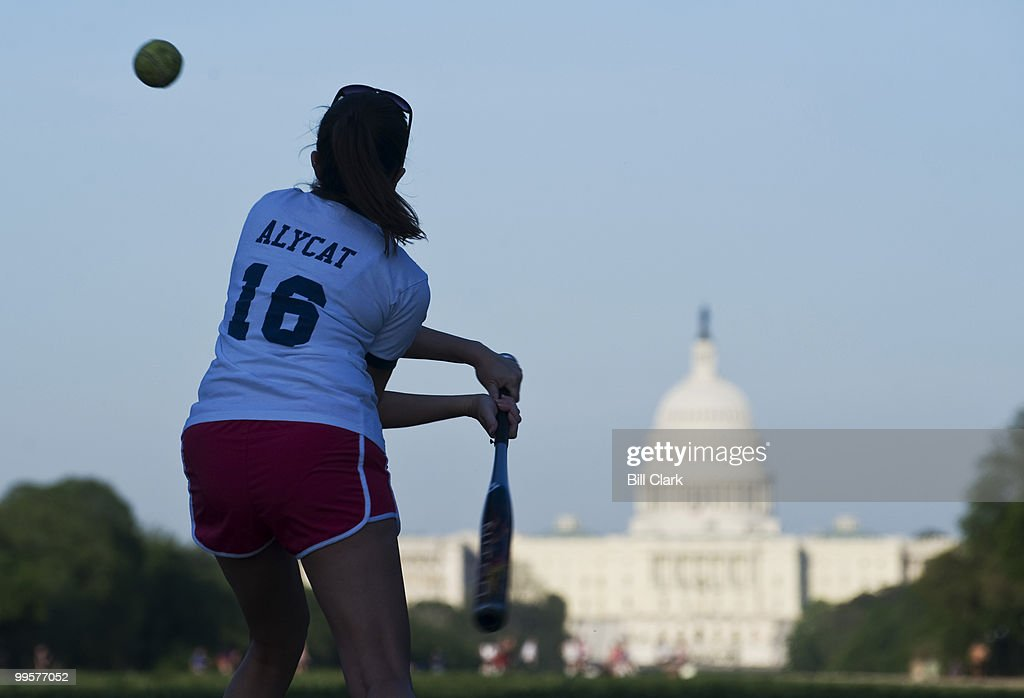 Alysson Vogt, of Rep. David Scott's office, bats during the Show Me Asses softball team practice on the National Mall on Monday, April 27, 2009.
