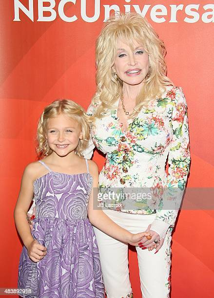 Alyvia Alyn Lind and Dolly Parton attend the NBCUniversal press tour 2015 at the Beverly Hilton Hotel on August 13 2015 in Beverly Hills California
