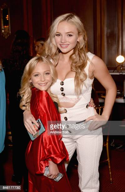 Alyvia Lind and Stevie Lynn Jones pose backstage at the Sherri Hill NYFW SS18 fashion show at Gotham Hall on September 12 2017 in New York City