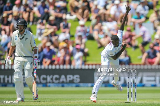 Alzarri Joseph of West Indies bowls while Tim Southee of New Zealand looks on during day two of the second test match in the series between New...