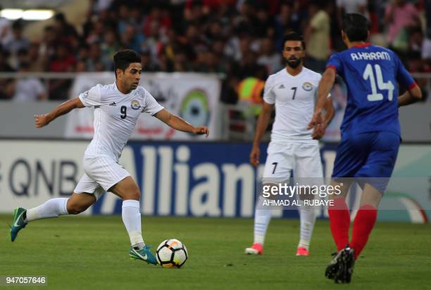 AlZawraa's Hussein Ali dribbles the ball as Manama's Ali Haram defends during the AFC Cup football match between Iraq's AlZawraa club and Bahrain's...