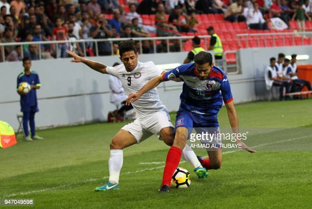 AlZawraa's Hussein Ali vies for the ball against Manama's Ali Haram during the AFC Cup football match between Iraq's AlZawraa club and Bahrain's...