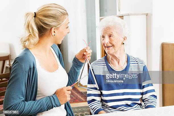 alzheimer therapy senior woman musical instrument - triangle percussion instrument stock photos and pictures