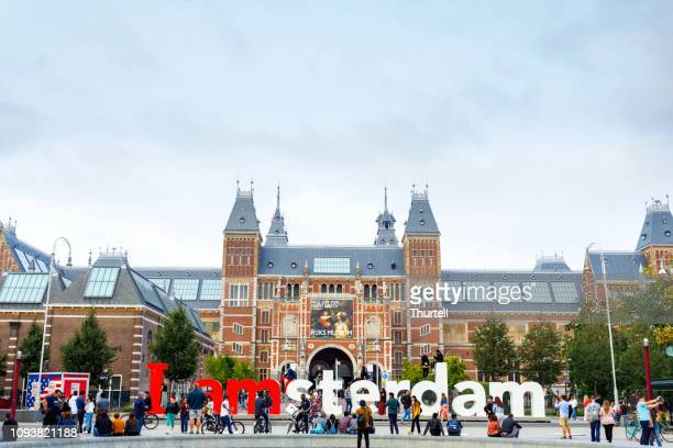 i am amsterdam sign in front of rijksmuseum - rijksmuseum stock photos and pictures