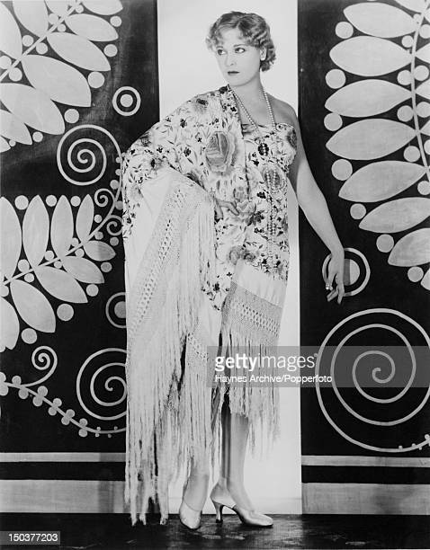 Am embroidered Spanish shawl worn togastyle as an informal tea gown 1929