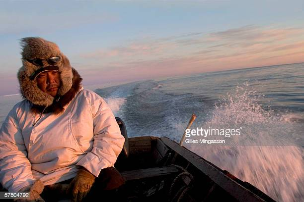 4 am Exhausted by a night of seal hunting Inupiat Eskimo Johnny Weyiouanna heads back to Shishmaref on the Chukchi Sea June 14 2005 near Shishmaref...