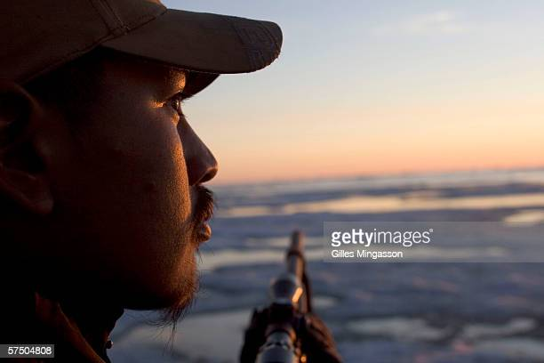 1230 am Inupiat Eskimo fred Weyiouanna scans the Chukchi Sea for seals during the traditional spring hunt June 16 2005 on the Chukchi Sea near...