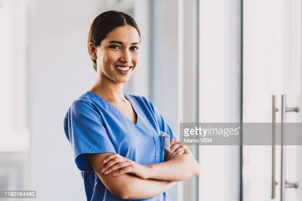 i am proud of my career choice - female nurse stock pictures, royalty-free photos & images