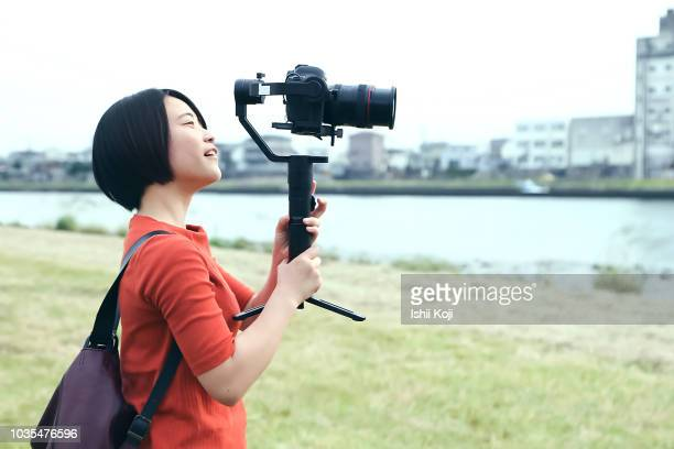i am shooting videos on the river side - adult videos japan stock pictures, royalty-free photos & images