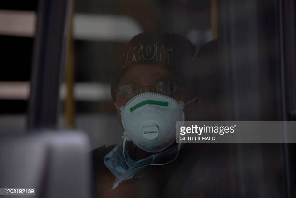 A bus driver for DDOT bus line in Detroit Michigan poses for a portrait while wearing her protective mask on March 2020 At 1201 am Tuesday March...