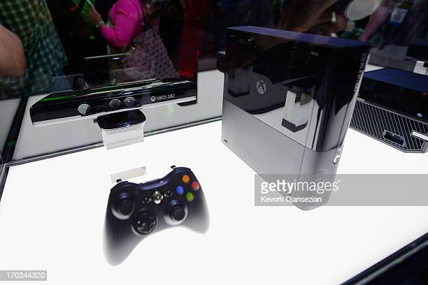 Am Xbox One and its controller on display at the Microsoft Xbox booth during the Electronics Expo 2013 at the Los Angeles Convention Center on June...