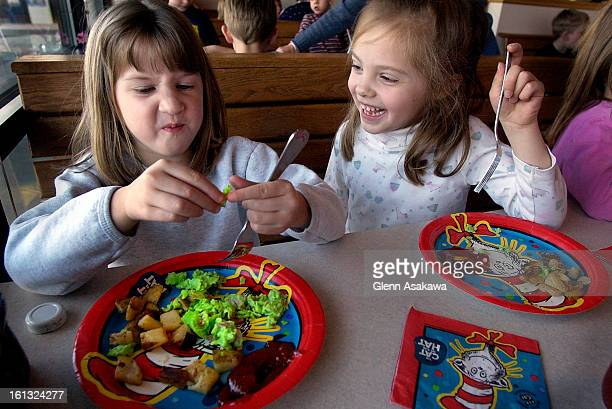 AM5yearold Madison <cq> DiMartini <cq> left examines a piece of green egg while classmate Hannah <cq> Shores <cq> also 5 laughs at DiMartini's...