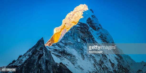 Ama Dablam 6812m snowy mountain peak glowing Himalayan sunrise Nepal
