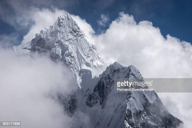 Ama Dablam mountain peak above the clouds in Everest region, Nepal
