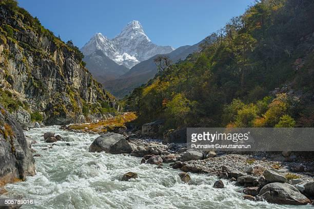 Ama Dablam mountain peak and small river
