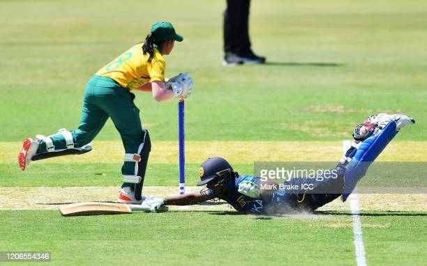 Ama Kanchana of Sri Lanka makes her crease as Trisha Chetty of South Africa takes off thje bails during the ICC Women's T20 Cricket World Cup Warm Up...