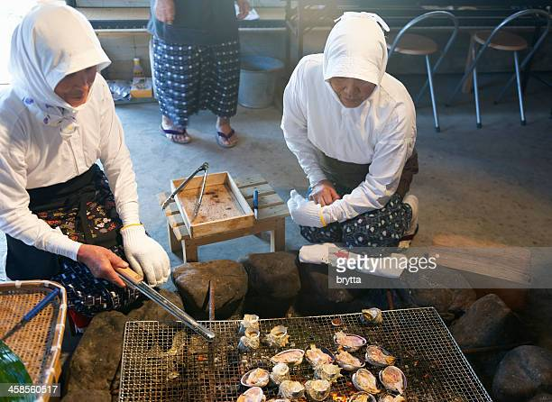 Ama shell divers grilling seafood