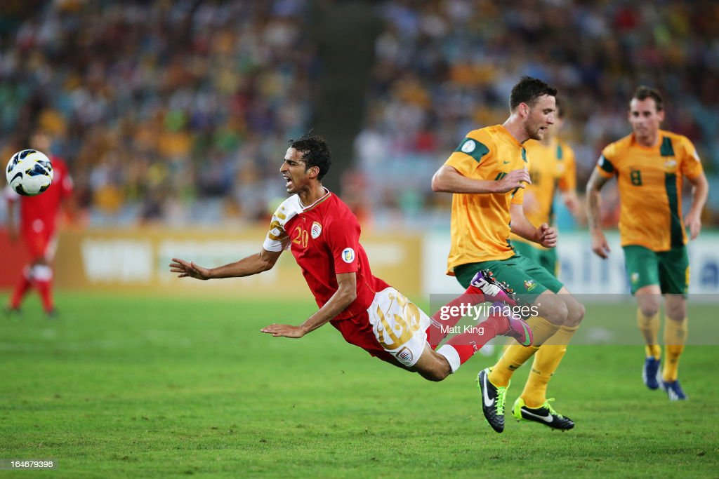 Amad Al Hosni of Oman is brought down after a challenge from Robbie Cornthwaite of the Socceroos during the FIFA 2014 World Cup Qualifier match between the Australian Socceroos and Oman at ANZ Stadium on March 26, 2013 in Sydney, Australia.