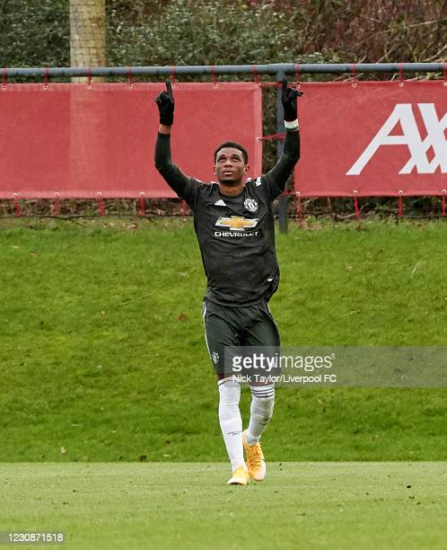 Amad Diallo of Manchester United celebrates after he scores from the penalty spot during the PL2 game at AXA Training Centre on January 30, 2021 in...