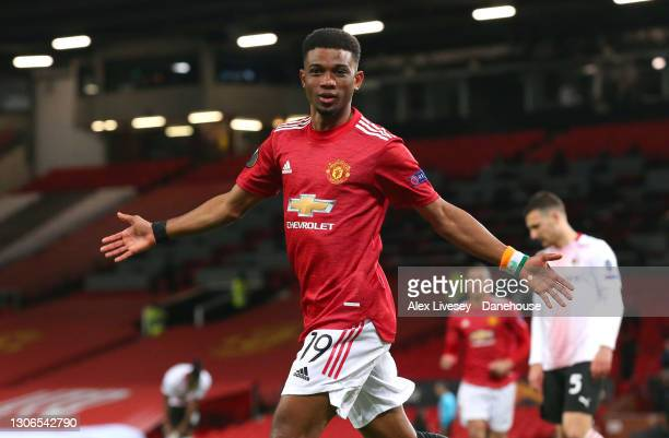 Amad Diallo of Manchester United celebrates scoring his teams first goal during the UEFA Europa League Round of 16 First Leg match between Manchester...
