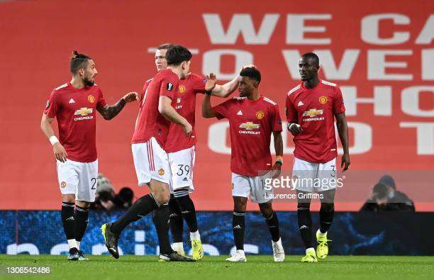 Amad Diallo of Manchester United celebrates with teammates Alex Telles, Scott McTominay, Harry Maguire and Eric Bailly after scoring their team's...