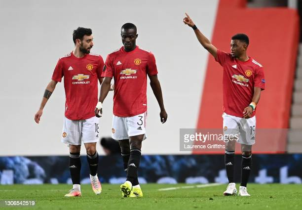Amad Diallo of Manchester United celebrates with teammates Bruno Fernandes and Eric Bailly after scoring their team's first goal during the UEFA...