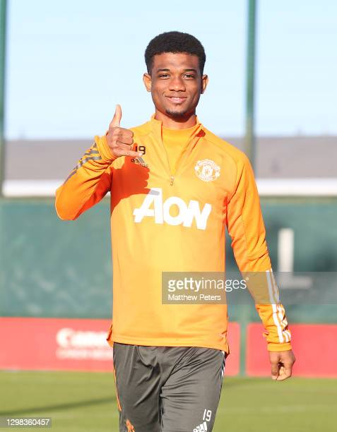 Amad Diallo of Manchester United in action during a first team training session at Aon Training Complex on January 25, 2021 in Manchester, England.