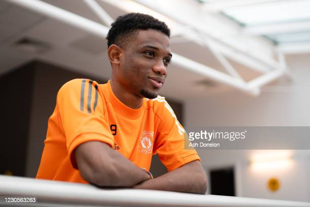 Amad Diallo of Manchester United poses for a portrait on his first day at Aon Training Complex on January 13, 2021 in Manchester, England.