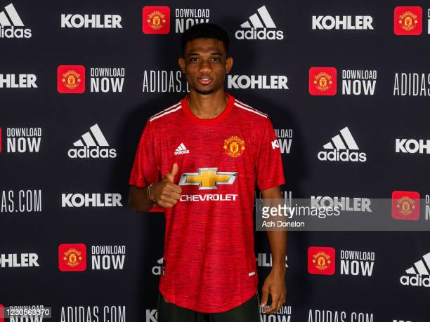 Amad Diallo of Manchester United poses with his team shirt on his first day at Aon Training Complex on January 13, 2021 in Manchester, England.