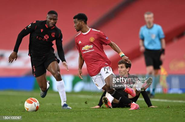 Amad Diallo of Manchester United runs with the ball during the UEFA Europa League Round of 32 match between Manchester United and Real Sociedad at...