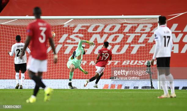 Amad Diallo of Manchester United scores their team's first goal during the UEFA Europa League Round of 16 First Leg match between Manchester United...