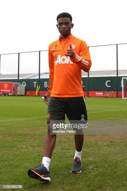 Amad Diallo of Manchester United walks out to a first team training session at Aon Training Complex on January 14, 2021 in Manchester, England.
