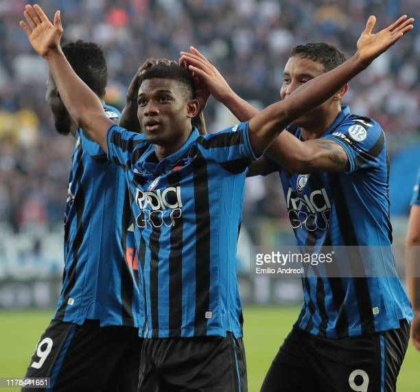 Amad Traore of Atalanta BC celebrates his goal with his teammate Luis Muriel during the Serie A match between Atalanta BC and Udinese Calcio at...