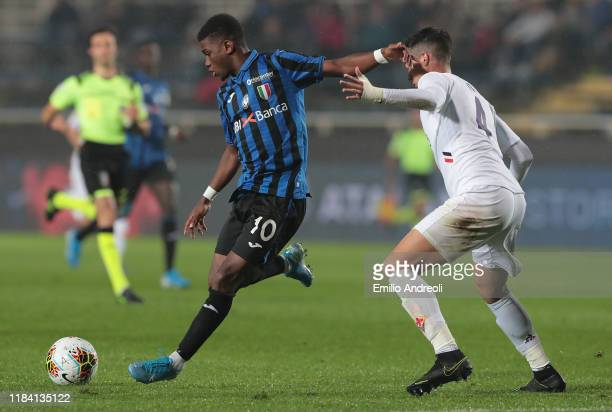 Amad Traore of Atalanta BC is challenged by Lorenzo Chiti of ACF Fiorentina during the Primavera TIM Supercup match between Atalanta BC U19 and ACF...