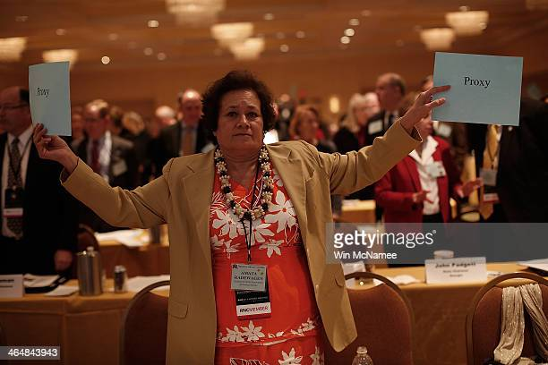 Amada Radewagen the National Committeewoman from American Samoa joins other delegates in voting in favor of an amendment to modify the Republican...