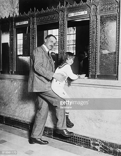 Amadeo Peter Giannini Lifting Jackie Coogan to Teller's Window
