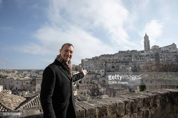Amadeus presenter of the rai 1 television program of the new year l'anno che verrà seen indicating and looking at the matera stones before the press...