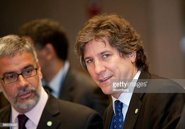 Amado Boudou economy minister of Argentina right talks to Roberto Feletti vicepresident of Banco de la Nacion SA during the Development Committee...
