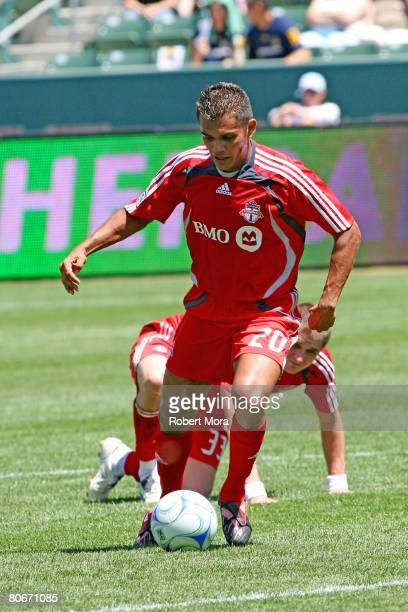 Amado Guevara of Toronto FC pushes the ball up the field during their MLS game against the Los Angeles Galaxy at the Home Depot Center on April 13...