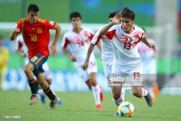 Amadoni Kamolov of Tajikistan dribbles downfield during the FIFA U17 World Cup Brazil 2019 group E match between Spain and Tajikistan at Estádio...