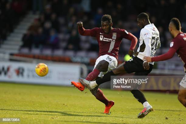 Amadou Bakayoko of Wallsall contest the ball with Aaron Pierre of Northampton Town during the Sky Bet League One match between Northampton Town and...